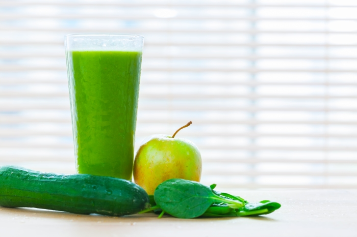 Fresh juice from green vegetables and fruits. Healthy vitamin drink.