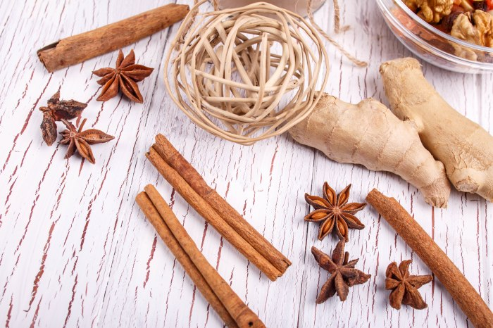 brown cinnamon sticks,ginger and grain clove lie on the table
