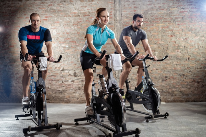 Young people cycling workout